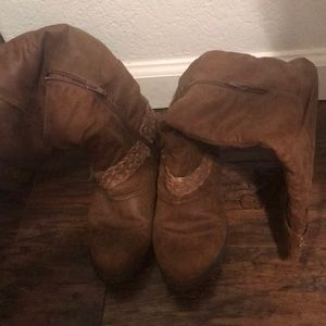 1 pair of knee length cowgirl boots.